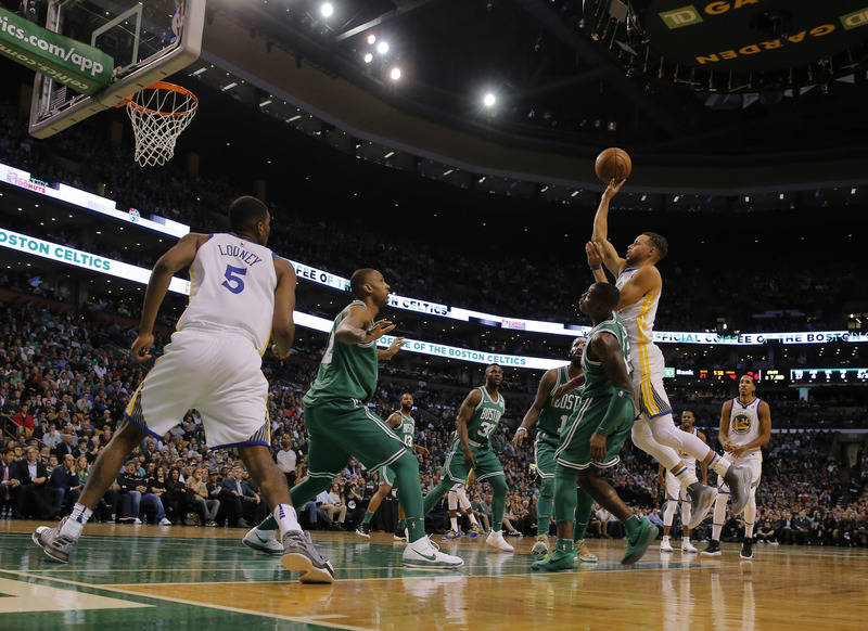 Nov 16, 2017; Boston, MA, USA; Golden State Warriors guard Stephen Curry (30) shoots against Boston Celtics guard Terry Rozier (12) in the second quarter at TD Garden. Mandatory Credit: David Butl ...