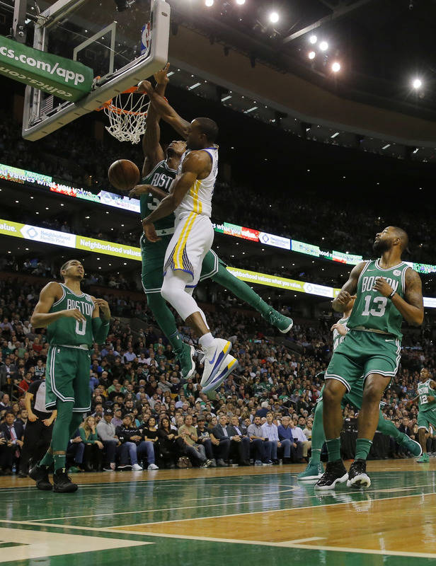 Nov 16, 2017; Boston, MA, USA; Golden State Warriors forward Andre Iguodala (9) drives to the basket against Boston Celtics guard Marcus Smart (36) in the second quarter at TD Garden. Mandatory Cr ...