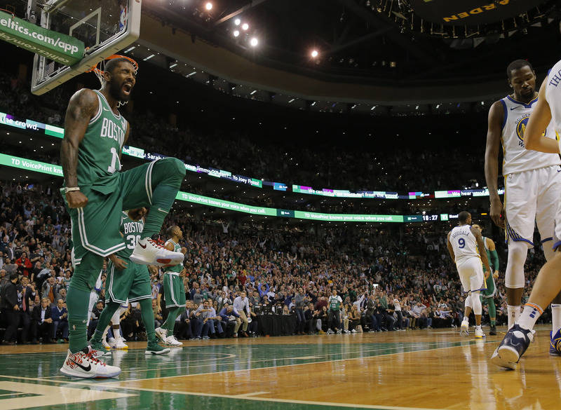 Nov 16, 2017; Boston, MA, USA; Boston Celtics guard Kyrie Irving (11) reacts after a play against the Golden State Warriors in the second half at TD Garden. The Celtics won 92-88. Mandatory Credit ...