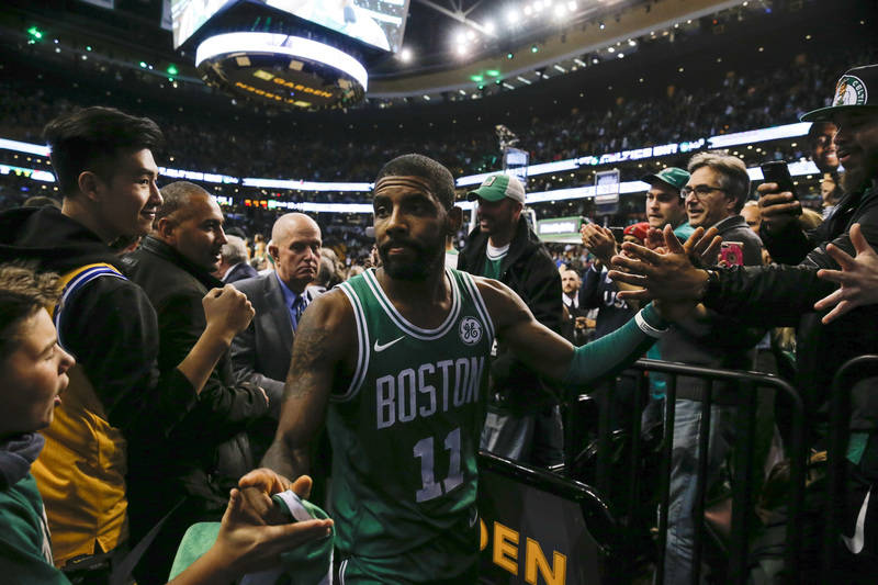 Nov 16, 2017; Boston, MA, USA; Boston Celtics guard Kyrie Irving (11) celebrates with fans while leaving the court after defeating the Golden State Warriors 92-88 at TD Garden. Mandatory Credit: D ...