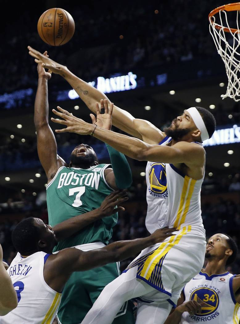 Boston Celtics' Jaylen Brown (7) battles Golden State Warriors' JaVale McGee (1) for a rebound during the first quarter of an NBA basketball game in Boston, Thursday, Nov. 16, 2017. (AP Photo/Mich ...