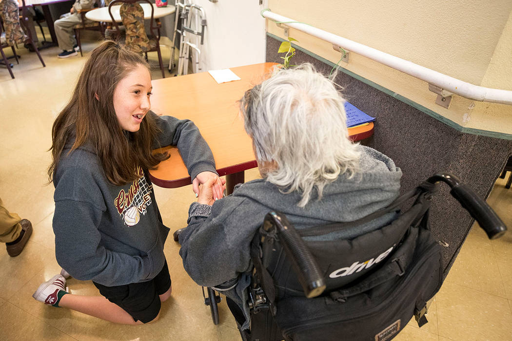 Faith Lutheran sixth-grader Olivia Faulice, 11, talks with Bernadita Blas, 73, while volunteering with her class at the Nevada Senior Services Adult Day Care Of Las Vegas on Friday, Nov. 17, 2017. ...