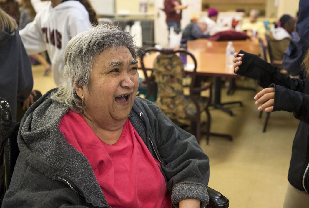 Bernadita Blas, 73, laughs as she talks with Faith Lutheran sixth graders volunteering at the Nevada Senior Services Adult Day Care Of Las Vegas on Friday, Nov. 17, 2017. Richard Brian Las Vegas R ...
