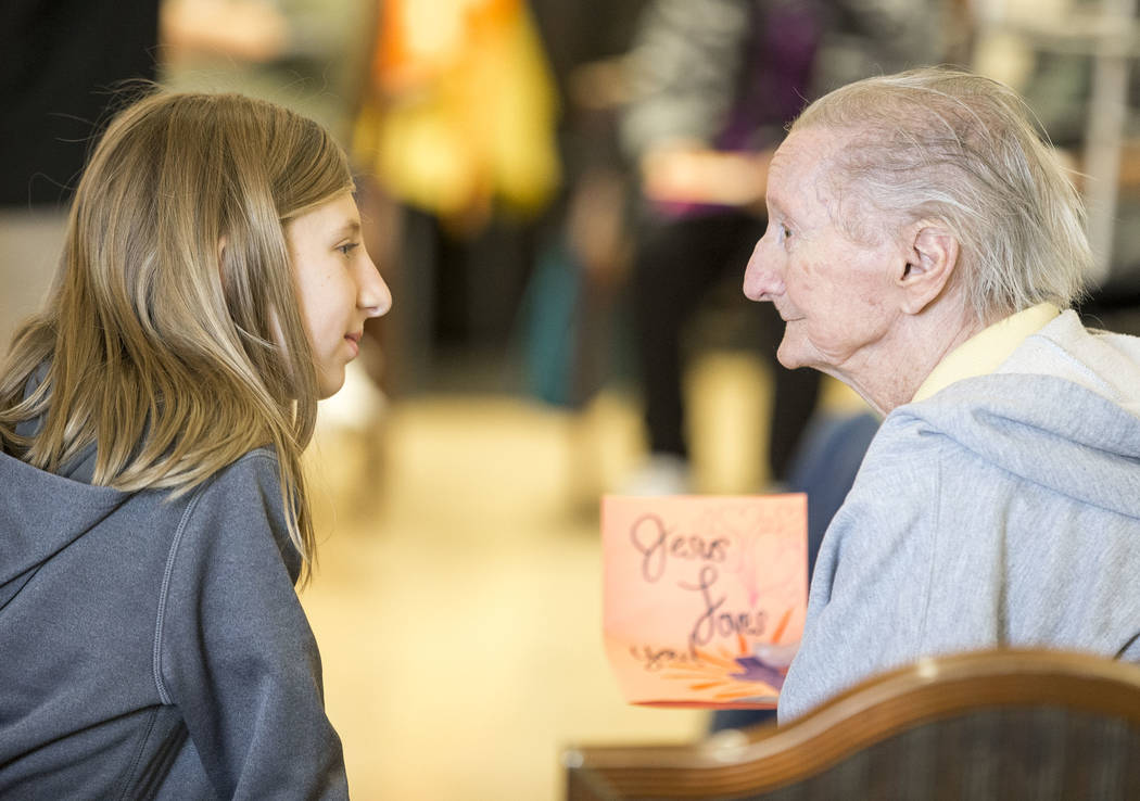 Faith Lutheran sixth-grader Rylan Dettling, 11, talks with Linda Brady, 78, as she volunteers at the Nevada Senior Services Adult Day Care Of Las Vegas on Friday, Nov. 17, 2017. Richard Brian Las  ...