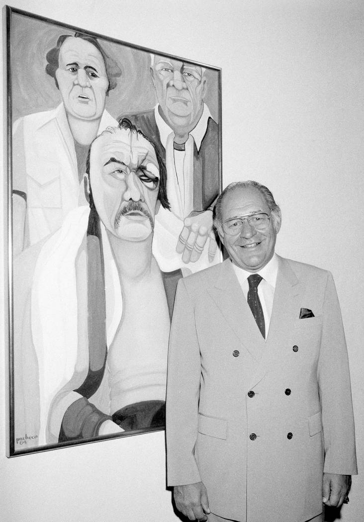 "In this May 10, 1984, file photo, Ferdie Pacheco stands in front of his painting of boxer Chuck Wepner at Manhattan's Spectrum Fine Art Gallery in New York. Fernando ""Ferdie"" Pacheco ..."