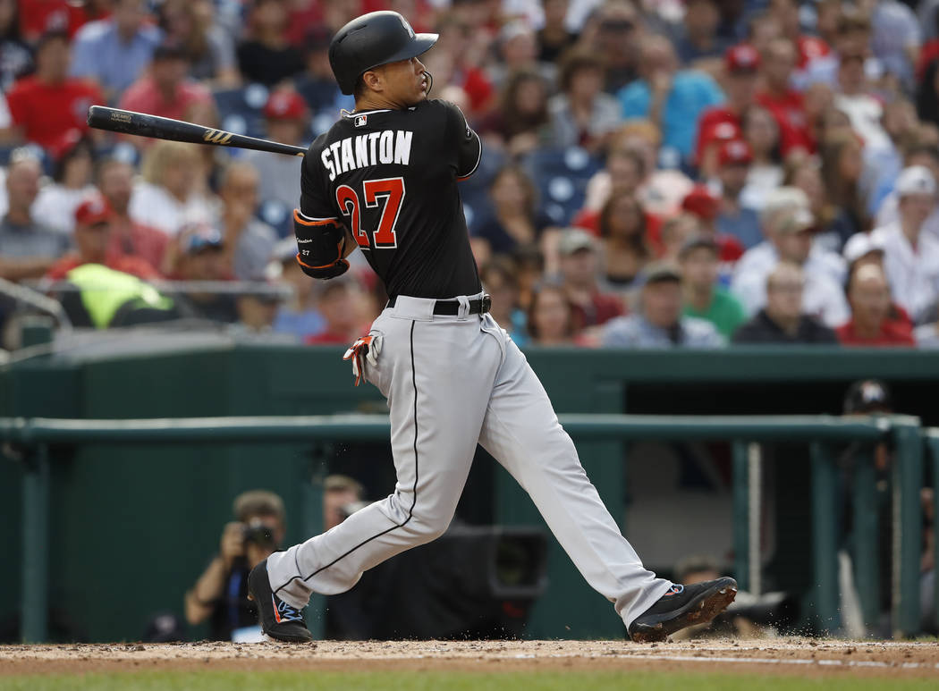 In this Aug. 10, 2017, file photo, Miami Marlins' Giancarlo Stanton (27) watches his two-run home run during the third inning of the team's baseball game against the Washington Nationals in Washin ...