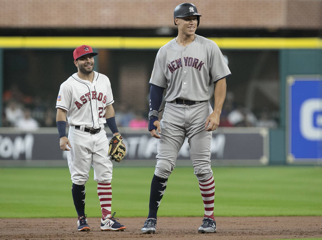 In this July 2, 2017, file photo, New York Yankees' Aaron Judge, right, and Houston Astros second baseman Jose Altuve have a conversation during the first inning of a baseball game in Houston. Alt ...