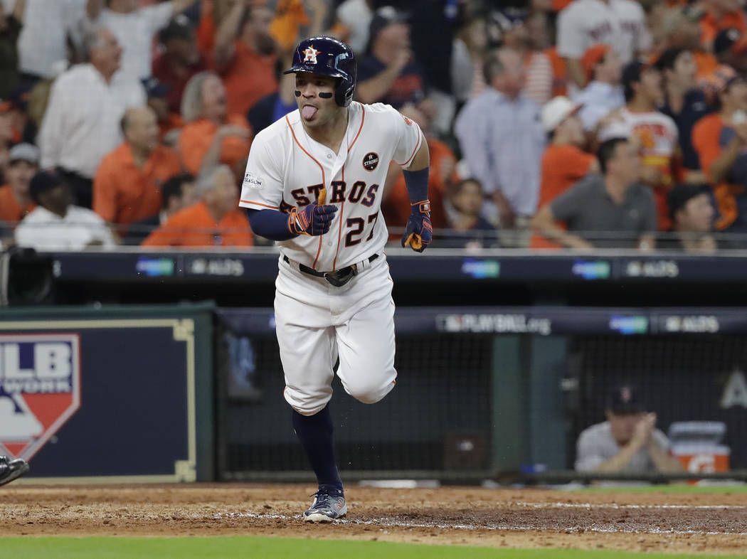 Houston Astros' Jose Altuve celebrates his solo home run, his third of the game, against the Boston Red Sox in the seventh inning in Game 1 of a baseball American League Division Series, Thursday, ...