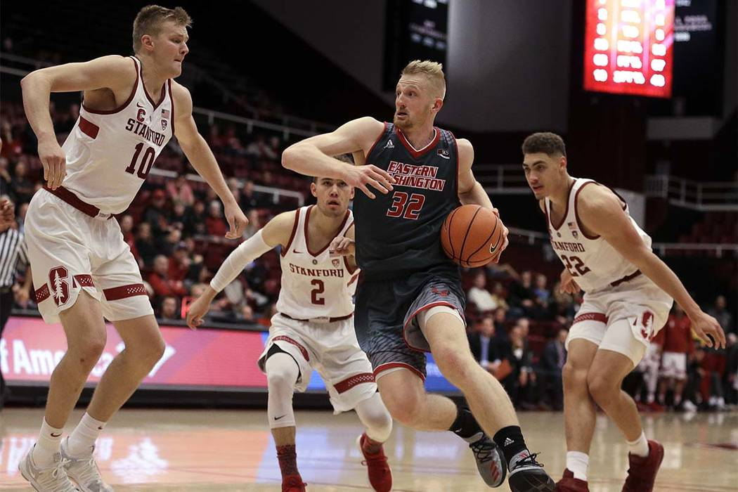 Eastern Washington's Bogdan Bliznyuk (32) drives the ball against Stanford's Michael Humphrey, left, Robert Cartwright (2) and Reid Travis (22) during the second half of an NCAA college basketball ...