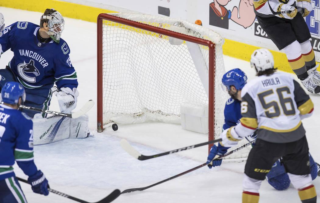 Vegas Golden Knights' Erik Haula (56), of Finland, scores against Vancouver Canucks' goalie Jacob Markstrom, left, of Sweden, during the third period of an NHL hockey game Thursday, Nov. 16, 2017, ...