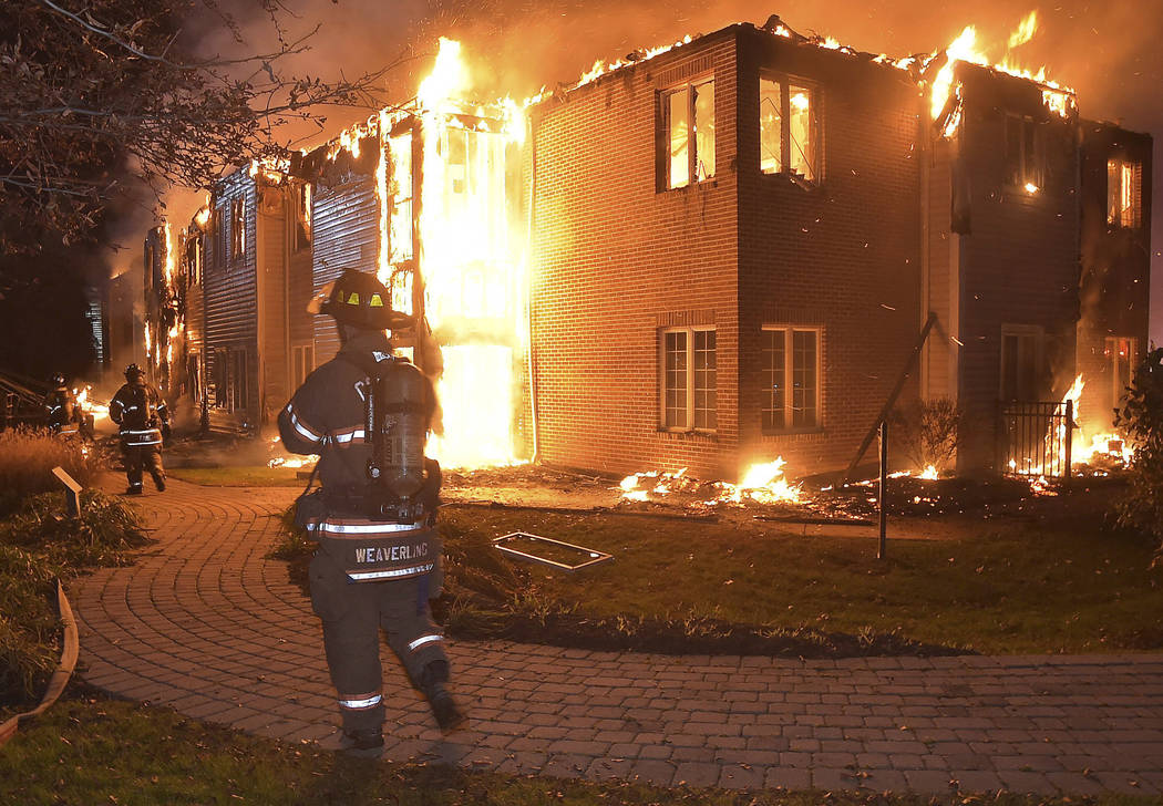 Firefighters battle a blaze at the Barclay Friends Senior Living Community in West Chester, Pa., Thursday, Nov. 16, 2017. Chester County emergency officials say at least 20 people have been taken  ...