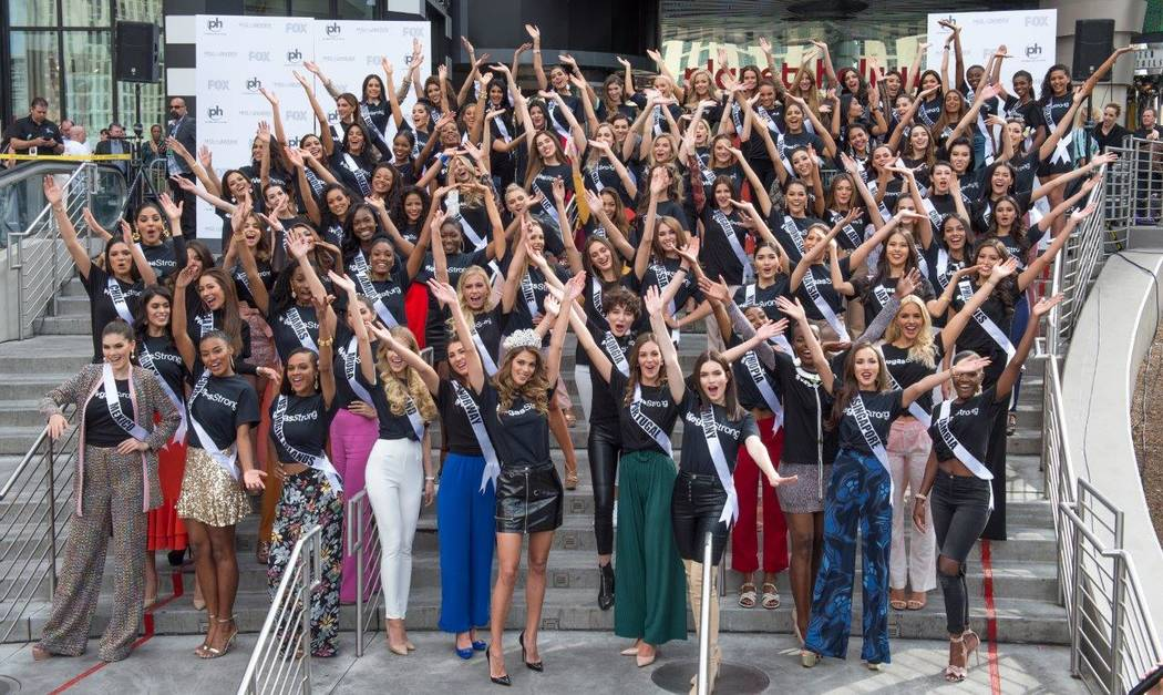 Miss Universe pageant contestants help celebrate the grand opening of his new Café Hollywood. (Tom Donoghue)