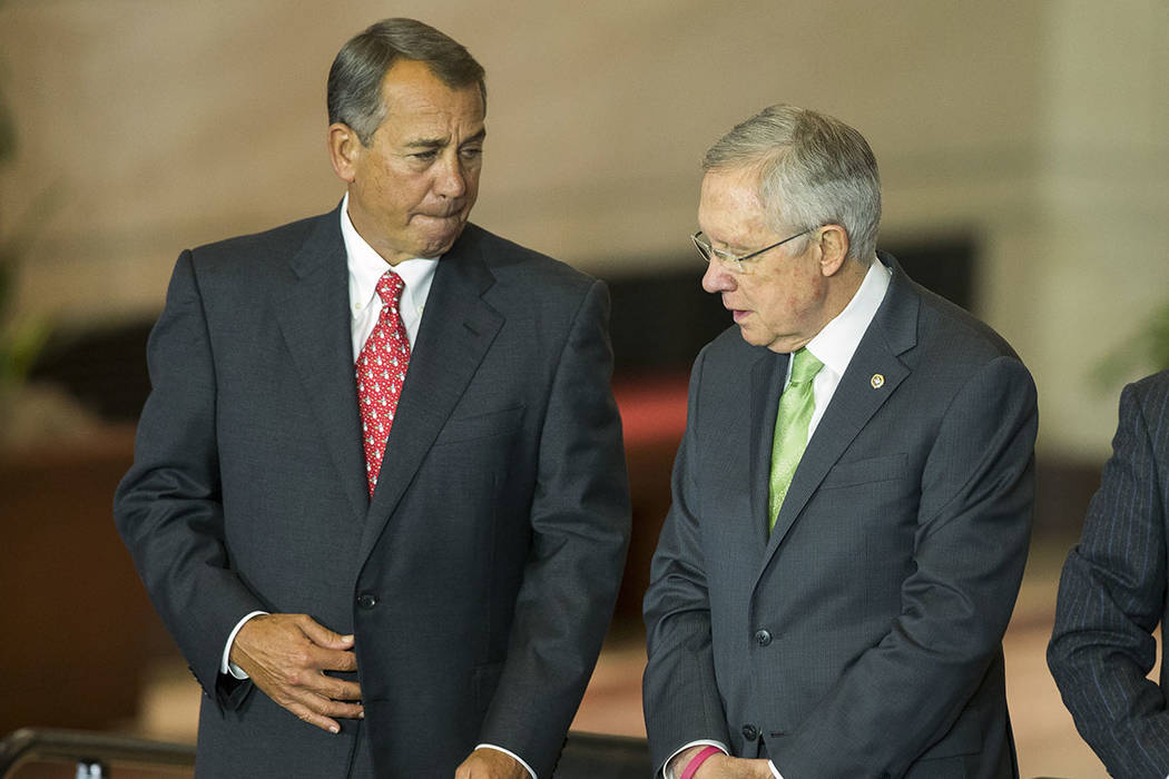 House Speaker John Boehner of Ohio, left, talks with Senate Majority Leader Harry Reid (D-Nev.) in Washington in 2014. (AP Photo/Evan Vucci)