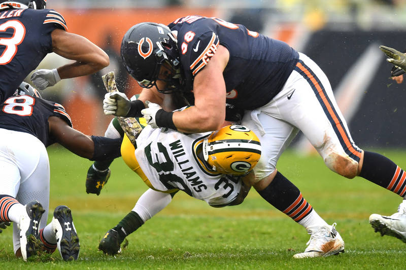 Nov 12, 2017; Chicago, IL, USA; Chicago Bears defensive end Mitch Unrein (98) tackles Green Bay Packers running back Jamaal Williams (30) during the second half at Soldier Field. The Packers won 2 ...