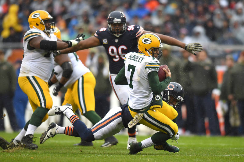 Nov 12, 2017; Chicago, IL, USA; Chicago Bears defense back Cre'von LeBlanc (22) sacks Green Bay Packers quarterback Brett Hundley (7) during the first half at Soldier Field. The Packers won 23-16. ...