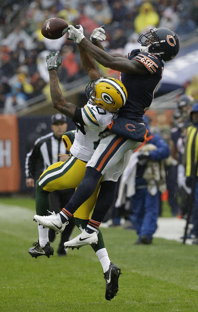 Green Bay Packers cornerback Kevin King (20) breaks up a pass intended for Chicago Bears wide receiver Josh Bellamy (15) during the first half of an NFL football game, Sunday, Nov. 12, 2017, in Ch ...
