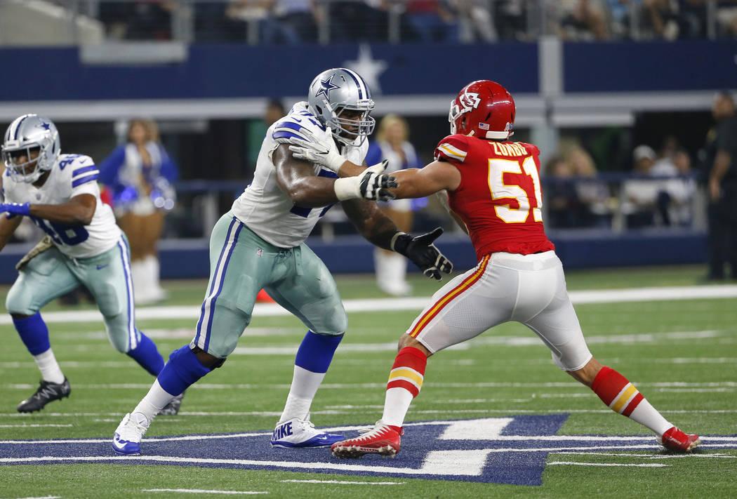 Dallas Cowboys' Tyron Smith (77) faces off against Kansas City Chiefs' Frank Zombo (51) during an NFL football game, Sunday, Nov. 5, 2017, in Arlington, Texas. (AP Photo/Roger Steinman)