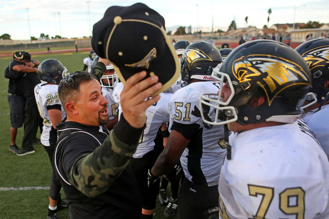 Spring Mountain's Head Coach Aaron Masden congratulates his team after they won the class 1A state football final neutral playoff game against Pahranagat Valley at Clark High School in Las Vegas,  ...