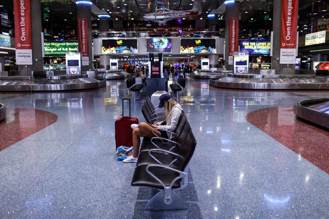 Anna Pieringer of Fort Worth, Texas, 21, sits at McCarran International Airport Terminal 1 baggage claim in Las Vegas, Friday, Oct. 13, 2017. Joel Angel Juarez Las Vegas Review-Journal @jajuarezphoto