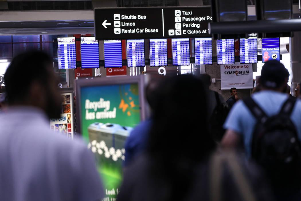 People walk through McCarran International Airport Terminal 1 baggage claim in Las Vegas, Friday, Oct. 13, 2017. Joel Angel Juarez Las Vegas Review-Journal @jajuarezphoto