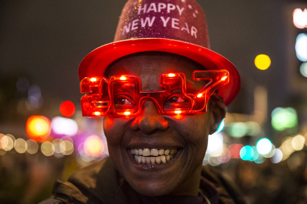 Eve Creque sells novelty New Years hats and glasses outside the Venetian hotel-casino on Saturday, Dec. 31, 2016, in Las Vegas. Benjamin Hager/Las Vegas Review-Journal