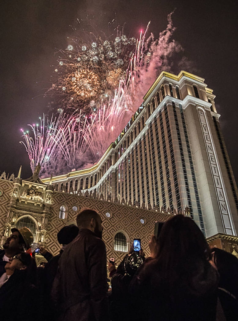 New Year's Eve party goers watch the fireworks outside the Venetian hotel-casino on the Strip on Saturday, Dec. 31, 2016, in Las Vegas. Benjamin Hager/Las Vegas Review-Journal