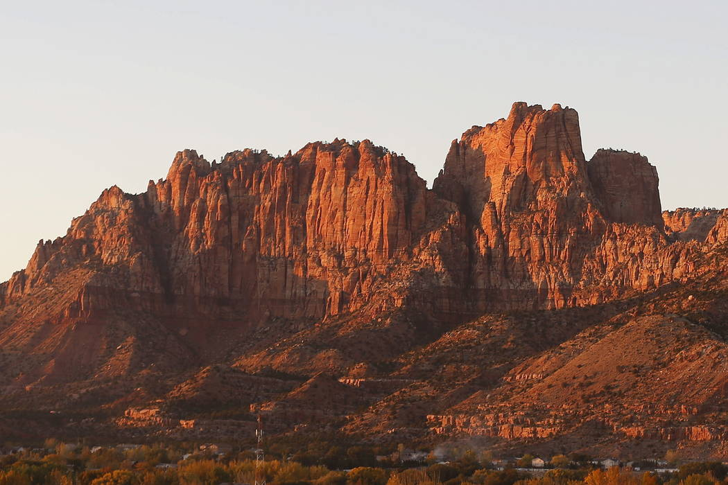 The mountains surrounding Hildale, Utah, and its sister city, Colorado City, Ariz., are seen at sunset last month.  (AP Photo/Rick Bowmer)