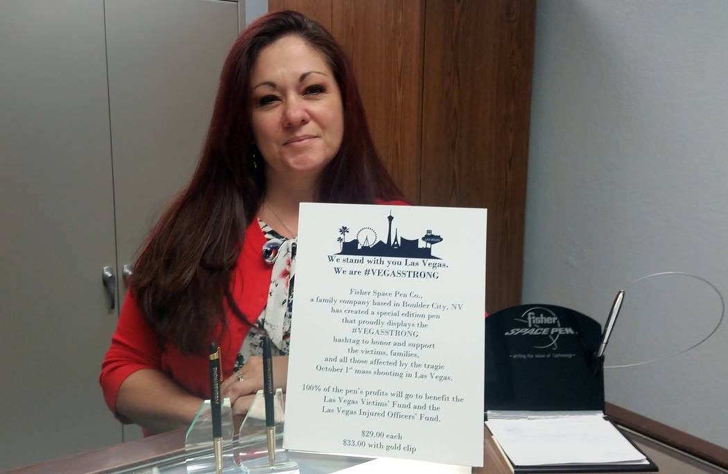 Christi Olsen, Fisher Space Pen's social media manager, showcases the VegasStrong pen she helped inspire at the company. All of its proceeds go to help those affected by the mass shooting in Las V ...