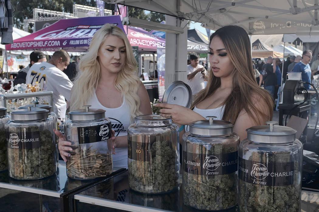 Vendors set up large jars with this season's harvest of marijuana for sale at the High Times Harvest Cup in San Bernardino, Calif. (AP Photo/Richard Vogel, File)