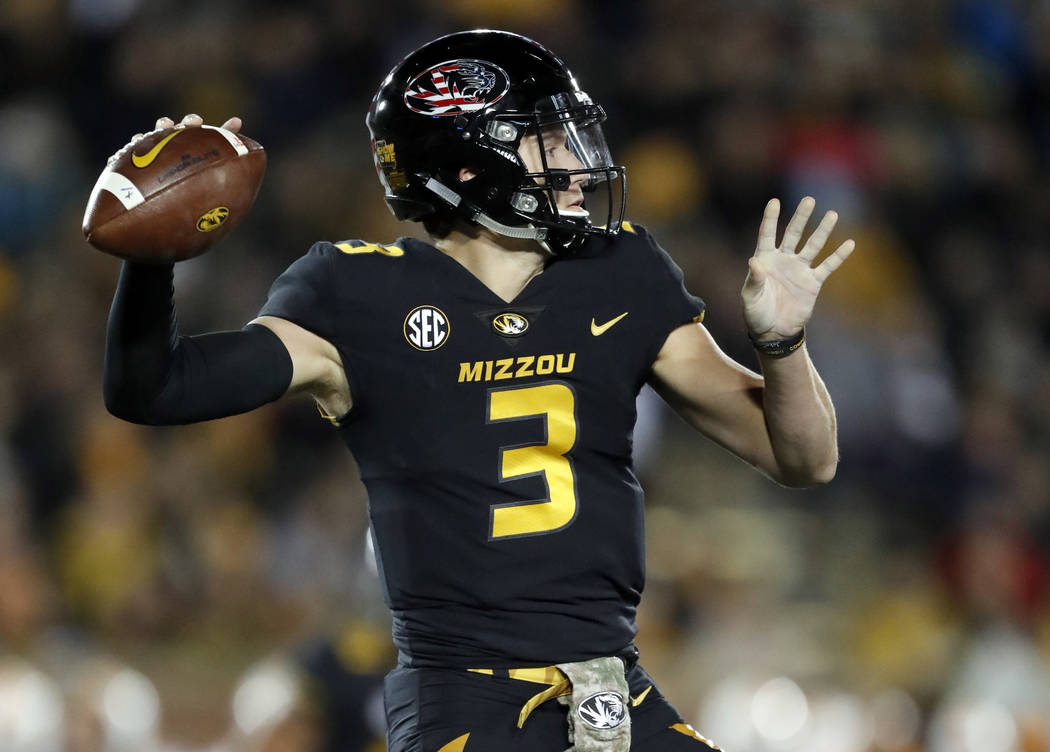 Missouri quarterback Drew Lock throws during the first half of an NCAA college football game against Tennessee, Saturday, Nov. 11, 2017, in Columbia, Mo. (AP Photo/Jeff Roberson)