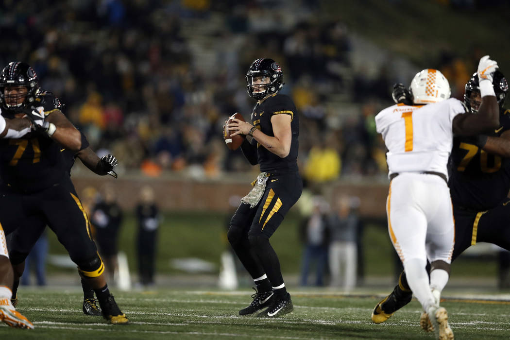 Missouri quarterback Drew Lock drops back to pass during the first half of an NCAA college football game against Tennessee Saturday, Nov. 11, 2017, in Columbia, Mo. (AP Photo/Jeff Roberson)
