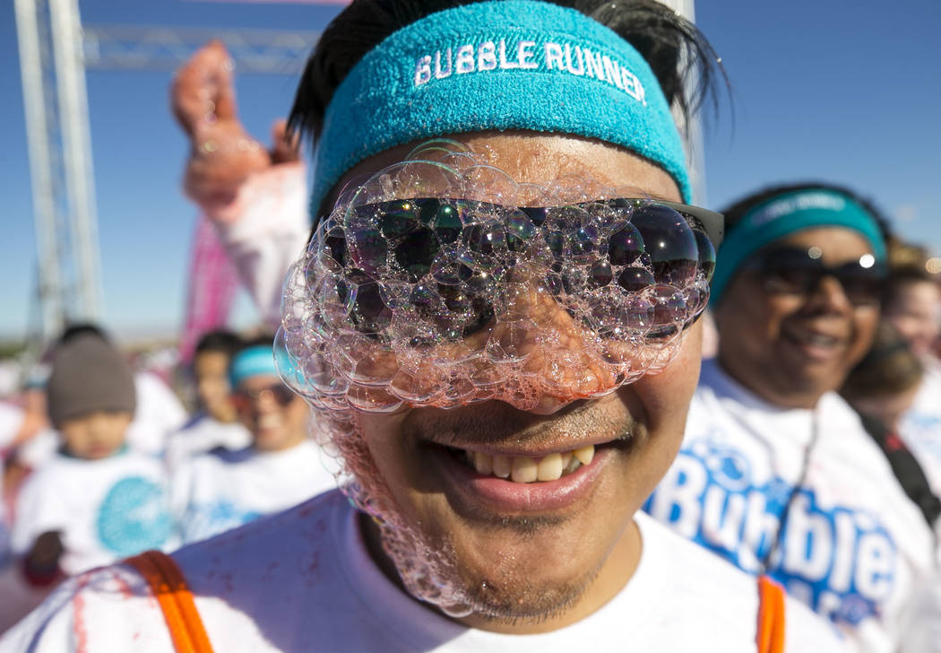 Las Vegas resident Augie Egbalic takes part in the Bubble Run 5K event at Sam Boyd Stadium in Las Vegas, Saturday, Nov. 18, 2017. Richard Brian Las Vegas Review-Journal @vegasphotograph