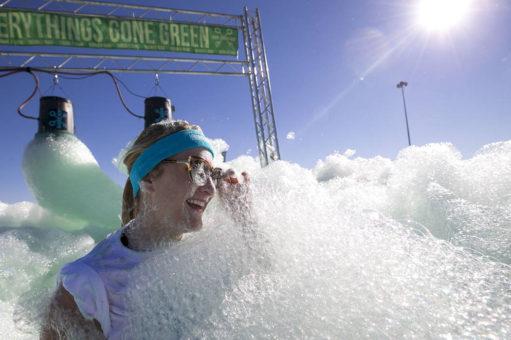 Las Vegas resident Sarah Arnold takes part in the Bubble Run 5K event at Sam Boyd Stadium in Las Vegas, Saturday, Nov. 18, 2017. Richard Brian Las Vegas Review-Journal @vegasphotograph