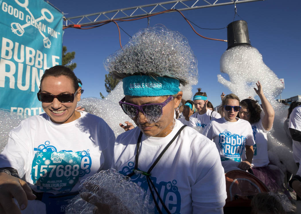 Participants leave the starting line during the Bubble Run 5K event at Sam Boyd Stadium in Las Vegas, Saturday, Nov. 18, 2017. Richard Brian Las Vegas Review-Journal @vegasphotograph