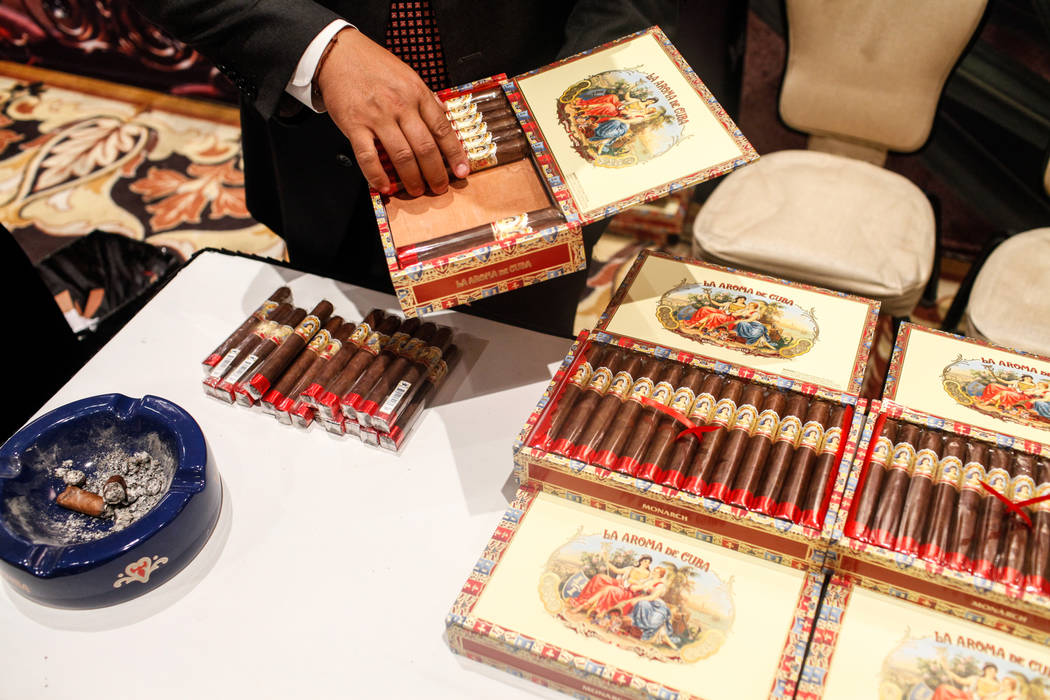 Narong Va of Los Angeles organizes cigars for Ashton during the Cigar Aficionado's Big Smoke Las Vegas weekend event at The Mirage in Las Vegas, Saturday, Nov. 18, 2017. Joel Angel Juarez Las Vega ...