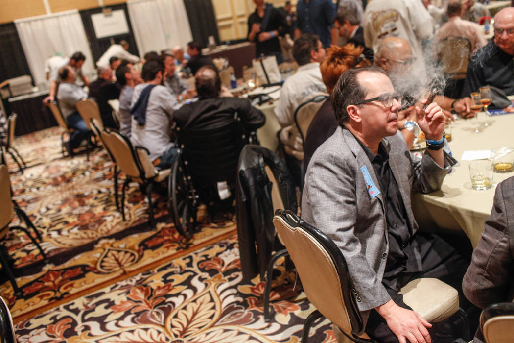 Matt Long of Seattle, 47, smokes a cigar during the Cigar Aficionado's Big Smoke Las Vegas weekend event at The Mirage in Las Vegas, Saturday, Nov. 18, 2017. Joel Angel Juarez Las Vegas Review-Jou ...