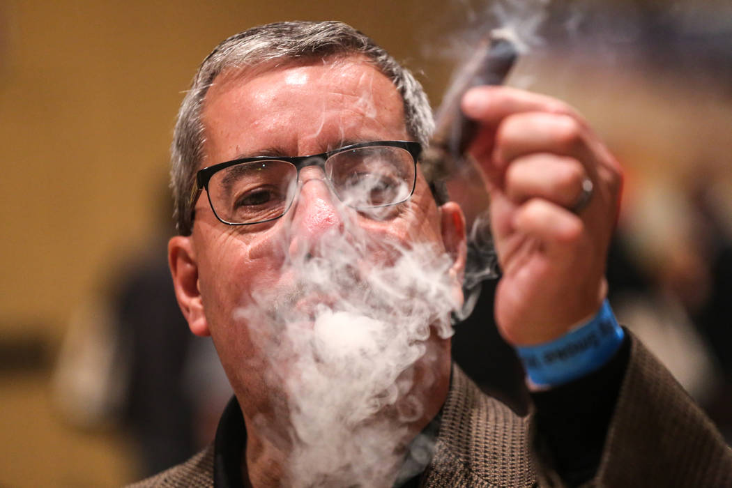 Pete Golder, 57, of Las Vegas, smokes a cigar during the Cigar Aficionado's Big Smoke Las Vegas weekend event at The Mirage in Las Vegas, Saturday, Nov. 18, 2017. Joel Angel Juarez Las Vegas Revie ...