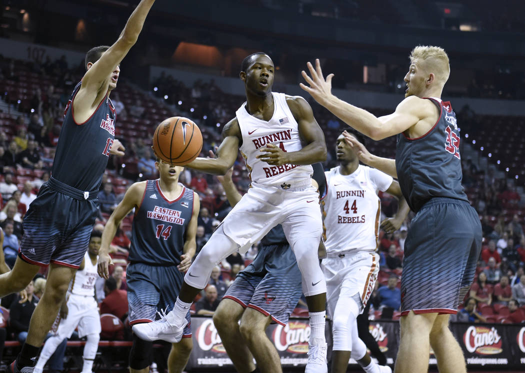 UNLV Rebels guard Jordan Johnson (24) dishes off a pass under the basket during their game against the Eastern Washington Eagles Friday, November 17, 2017, at the Thomas & Mack Center. UNLV wo ...