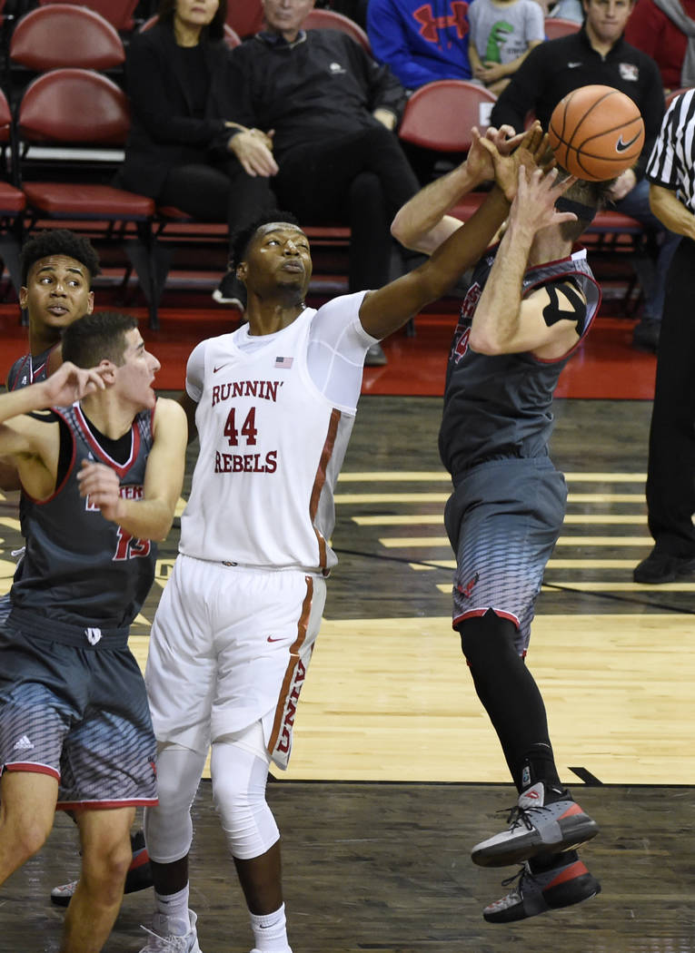 UNLV Rebels forward Brandon McCoy (44) knocks the ball away from Eastern Washington Eagles forward Mason Peatling (14) during their game Friday, November 17, 2017, at the Thomas & Mack Center. ...