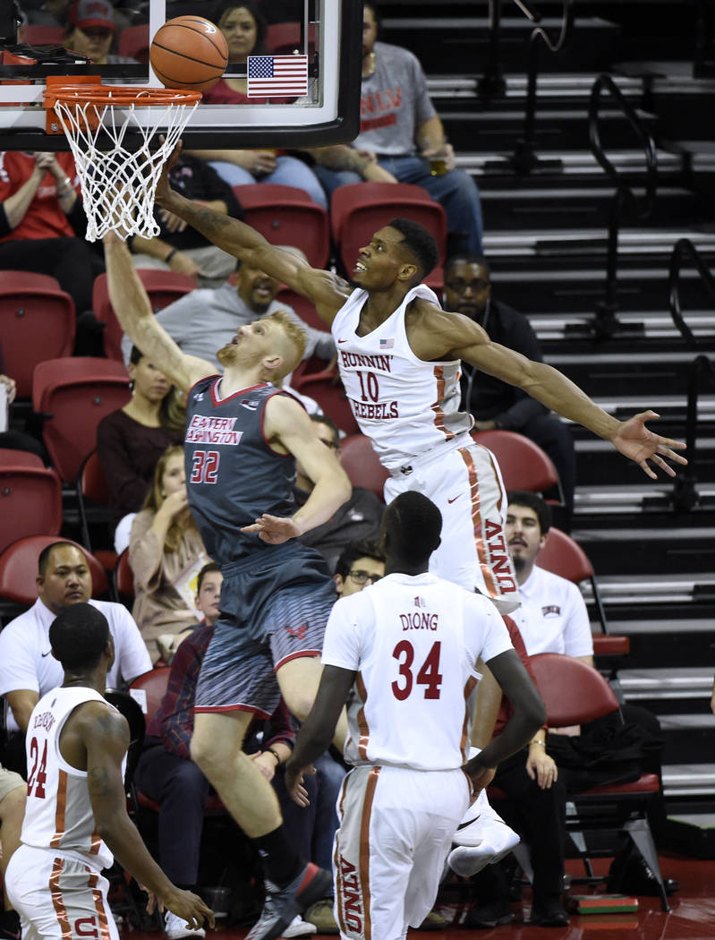 UNLV Rebels forward Shakur Juiston (10) tips away a shot by Eastern Washington Eagles guard Bogdan Bliznyuk (32) during their game Friday, November 17, 2017, at the Thomas & Mack Center. UNLV  ...