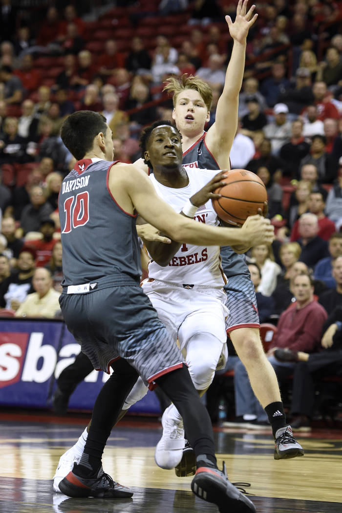 UNLV Rebels guard Kris Clyburn (1) drives between Eastern Washington Eagles guard Jacob Davison (10) andEastern Washington Eagles guard Jack Perry (11) during their game Friday, November 17, 2017, ...