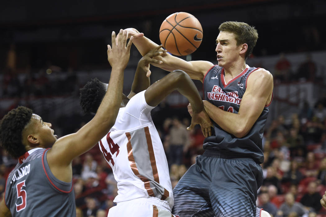 Eastern Washington Eagles forward Mason Peatling (14) fouls UNLV Rebels forward Brandon McCoy (44) during their game Friday, November 17, 2017, at the Thomas & Mack Center. UNLV won the game 9 ...
