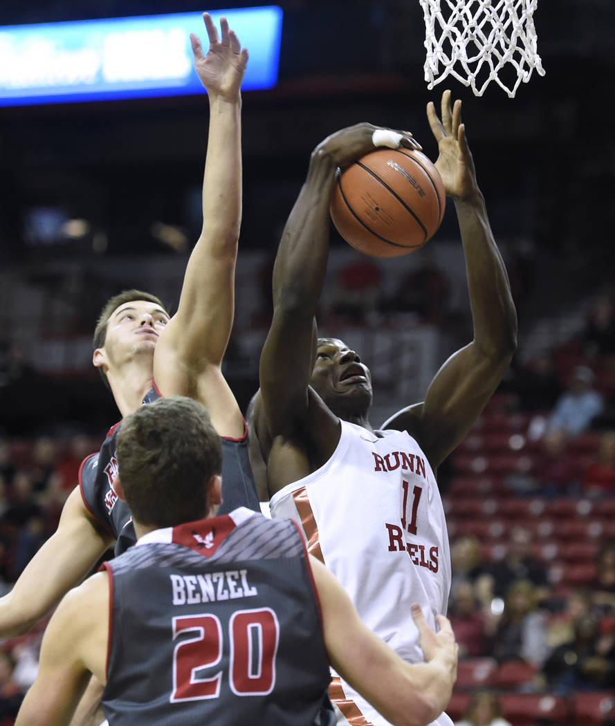 UNLV Rebels forward Cheickna Dembele (11) grabs a rebound against the Eastern Washington Eagles during their game Friday, November 17, 2017, at the Thomas & Mack Center. UNLV won the game 91-7 ...