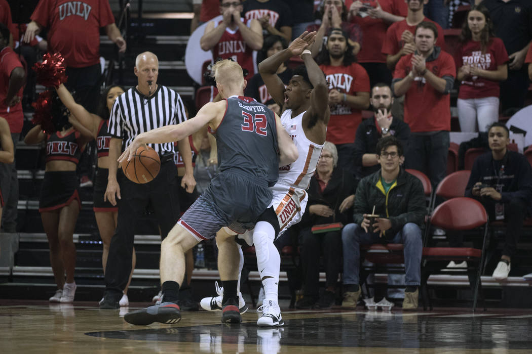 UNLV Rebels guard Jovan Mooring (30) draws a foul on Eastern Washington Eagles guard Bogdan Bliznyuk (32) during their game Friday, November 17, 2017, at the Thomas & Mack Center. UNLV won the ...