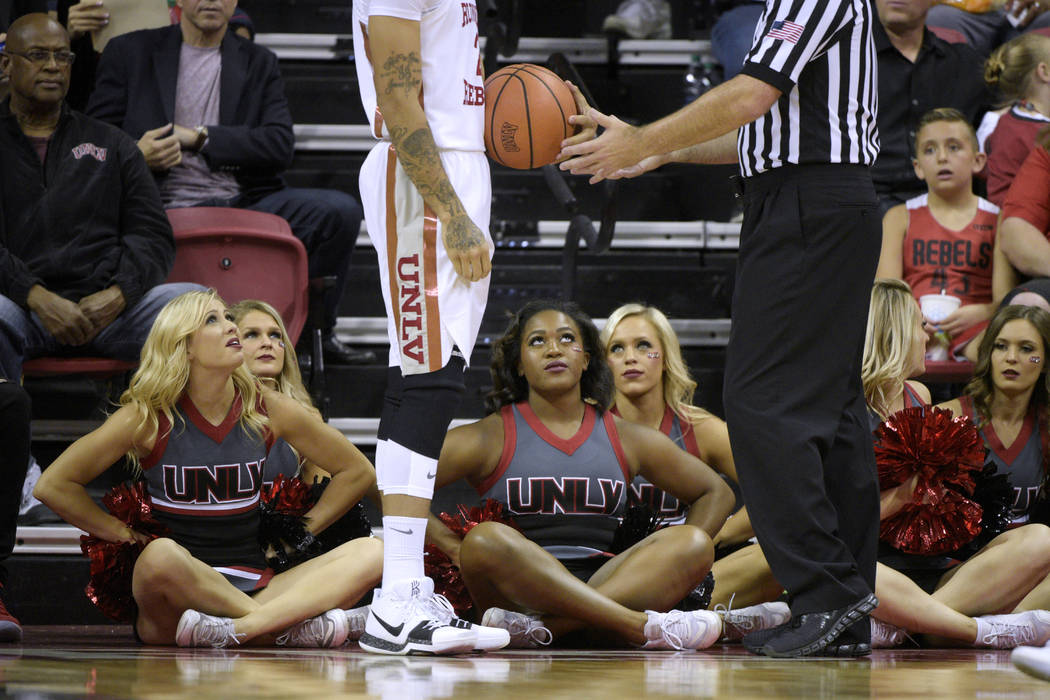 UNLV cheerleaders look up as UNLV Rebels guard Jordan Johnson (24) hands the ball over after fouling against the Eastern Washington Eagles during their game Friday, November 17, 2017, at the Thoma ...