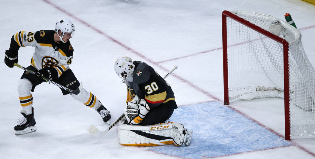 Boston Bruins center Danton Heinen (43), left, attempts a shot as Vegas Golden Knights goalie Malcolm Subban (30), right, blocks it during the third period of an NHL hockey game at T-Mobile Arena  ...