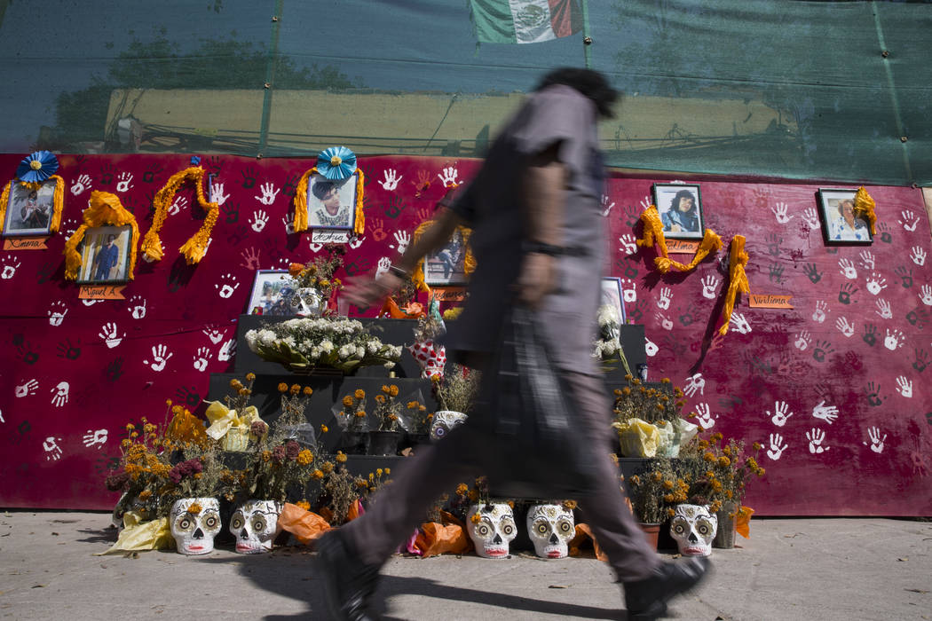A memorial for the victims who died after their apartment complex, Unidad Habitacional de Tlalpan, collapsed during the Sept. 19 earthquake in Mexico City, Mexico, Friday, Nov. 17, 2017. Erik Verd ...