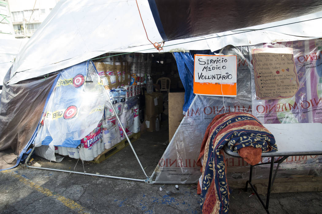 A medical tent nside an outdoor shelter created by victims living in the Unidad Habitacional de Tlalpan apartment complex, which suffered structural damage during the Sept. 19 earthquake in Mexico ...