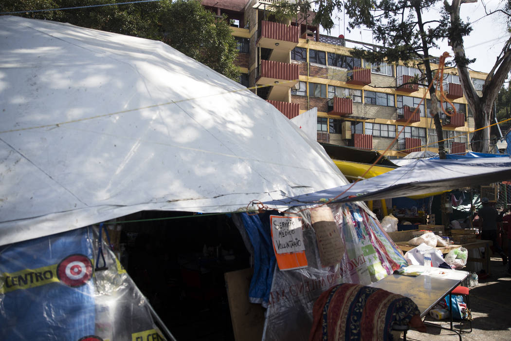 A medial tent outside of the uninhabited apartment complex, Unidad Habitacional de Tlalpan, which suffered structural damage during the Sept. 19 earthquake in Mexico City, Mexico, Friday, Nov. 17, ...