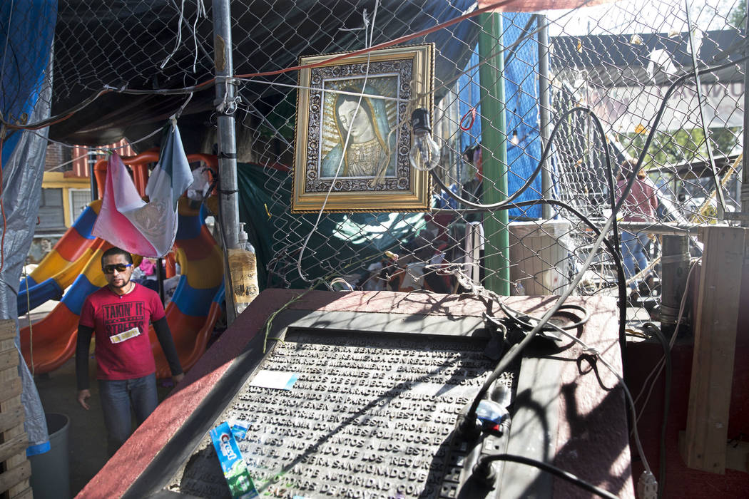 Inside an outdoor shelter created by victims living in the Unidad Habitacional de Tlalpan apartment complex, which suffered structural damage during the Sept. 19 earthquake in Mexico City, Mexico, ...